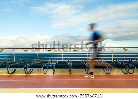 Blurred Joggers on cruise ship running track #755766715