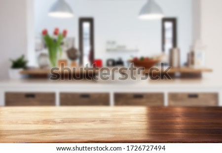 blurred kitchen interior  and desk space home background