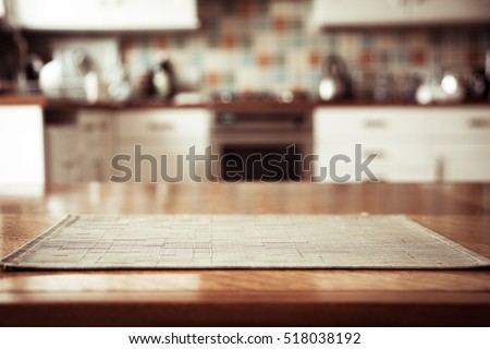 Blurred kitchen interior and napkin and desk space #518038192