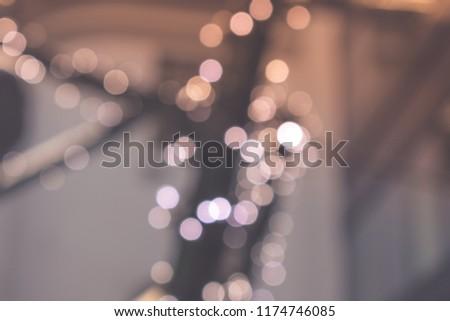Blurred light bulbs on the street. Defocused lights. #1174746085