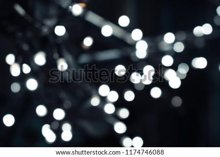 Blurred light bulbs on the street. Defocused lights. #1174746088