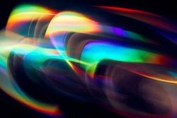 Blurred Light painting one exposure in camera. light glares with a spectral gradient on a dark background. Multicolored abstract colorful line. Unusual light effect.