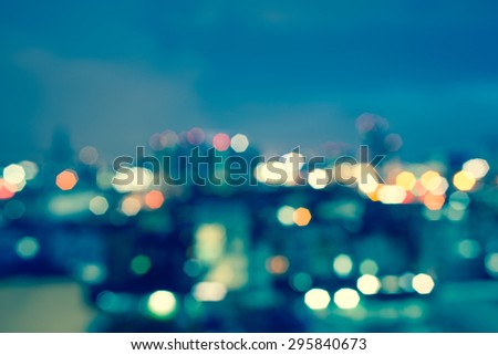 blurred lights cityscape at night with vintage tone, blurred for cityscape background or backdrop #295840673