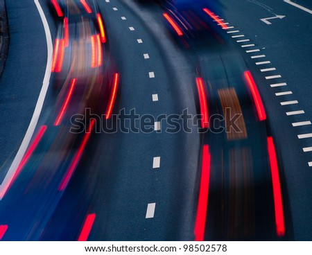 blurred lights of cars on a highway at evening