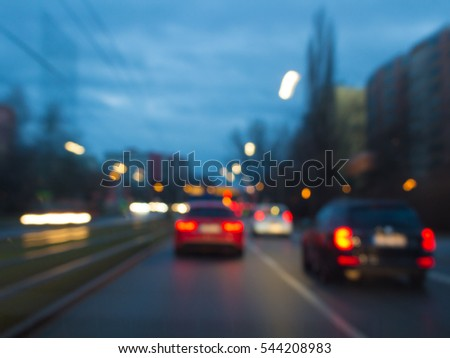 blurred lights of Road traffic cars on street in germany at evening #544208983