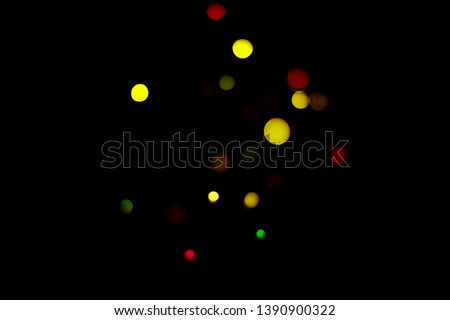 Blurred lights on black background. Abstract tetxure. Effect on photo