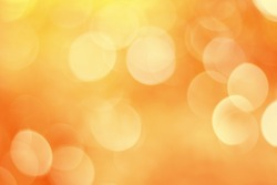Blurred Lights on orange background or Lights on orange background. Filtered color.