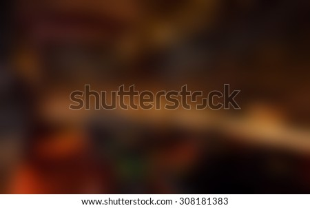 Blurred living room/sitting room background.