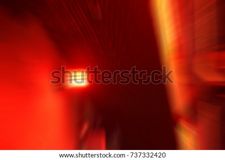 blurred low key Illuminated factory industry red alert emergency light with copy space  for background