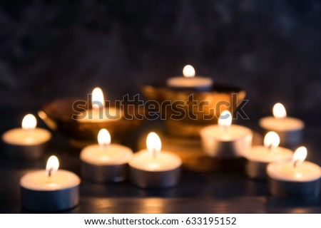 blurred Many burning candles    in concept spa relaxing , holiday ,merry christmas, REST IN PEACE