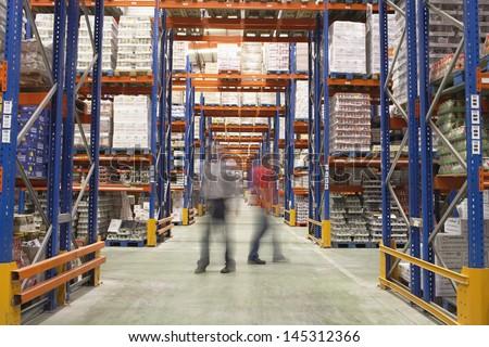 Blurred men walking in the warehouse #145312366