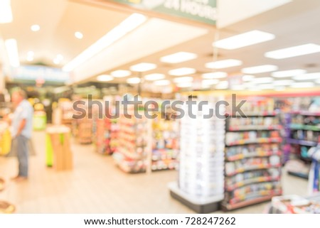 Blurred modern convenience store gas station in Arkansas, USA. Variety items on display impulse snacks, energy drink, coffee, hot food, tobacco, cigarettes, clothes, lottery tickets. Customer shopping #728247262