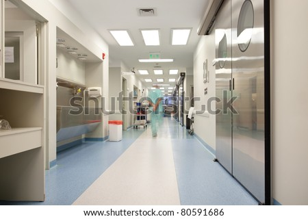 Blurred motion of doctor walking in a hospital corridor