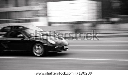 Blurred motion of fast moving sport car