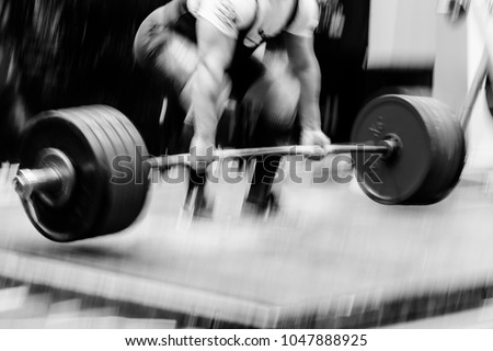 blurred motion powerlifter exercise deadlift heavy barbell