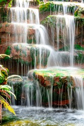Blurred motion waterfall on stone in beautiful nature on hills