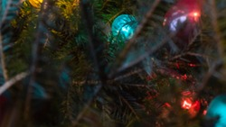 Blurred Multicolored light bulbs. Vintage, luxury lamp glowing on Xmas tree.Festive mood.Garland of lamps or glass lantern,the glow of light bulbs.Xmas decor.Holiday,Decorative string lights.