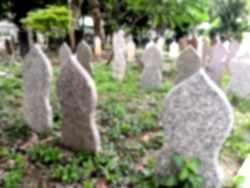Blurred Muslim tombstone in the cemetery