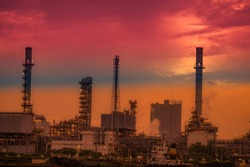 Blurred natural background of the morning sunshine along the river, breathtaking views (cargo ship, oil refinery), boat transportation