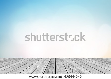 blurred natural blue sky gradient backdrop wall with old white wood colored background texture tabletop:rustic aged tiles wooden with blur pastel cool wallpaper.advertise,show your products on display