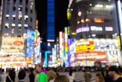 Blurred Neon Signs Illuminate Tokyo's busy Shinjuku Neighborhood at Night