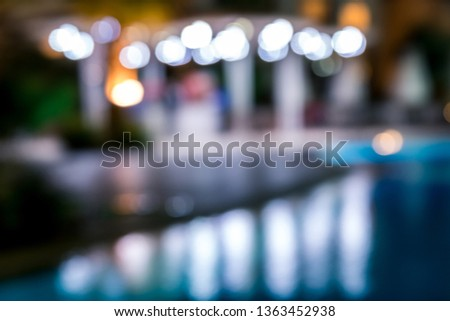 blurred night background, colored lights, water and buildings in defocus. Horizontal frame #1363452938