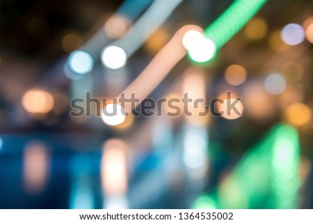 blurred night background, colored lights, water and buildings in defocus. Horizontal frame #1364535002