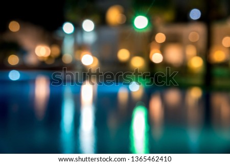 blurred night background, colored lights, water and buildings in defocus. Horizontal frame #1365462410