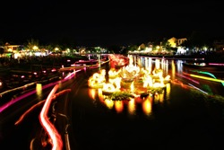 Blurred night light in Vietnam,Traditional multicolored paper lanterns with candles floating down the river at night ,unseen Vietnam,Hoi An