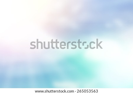 Blurred of a blue sky with sun ray background and white clouds