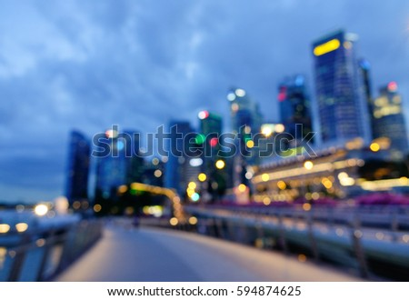 Blurred of business district with many tall buildings at twilight in Singapore. #594874625