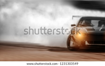 Blurred of Car drifting, Sport car wheel drifting and a lot of smoking background.