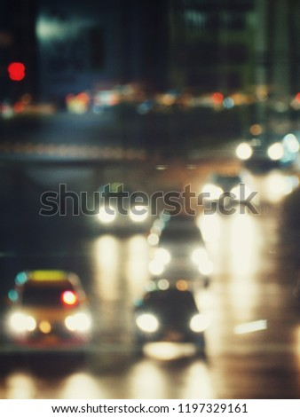 Blurred of car on road at night #1197329161