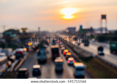 Blurred of car on road in sunset #541715566