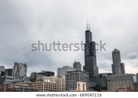 Blurred of Downtown Chicago on The Cloud Sky Background / With Copy Space,Filter Color Effect Dark Tone.