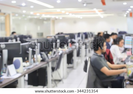 blurred of employee working call centre hotline at office computer indoor room concept.