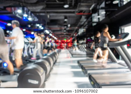 Blurred of fitness gym center interior background with two rows of cardio machine #1096107002