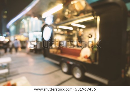 Blurred of food trucks parking.
