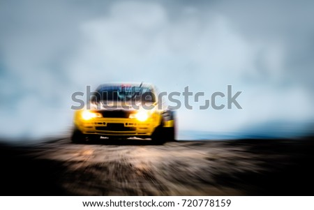 Blurred of image diffusion race drift car with lots of smoke from burning tires on speed track