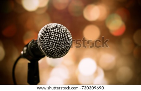 Blurred of microphones in seminar room, talking speech in conference hall light with microphone and keynote. Speech is vocalized form of communication humans. #730309690