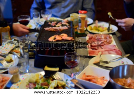 Blurred of people meeting and enjoy drinking ,eating barbecue food and having dinner in party birthday inside the house and talking together at the room. Food, holidays and healthy care concept. #1022112250