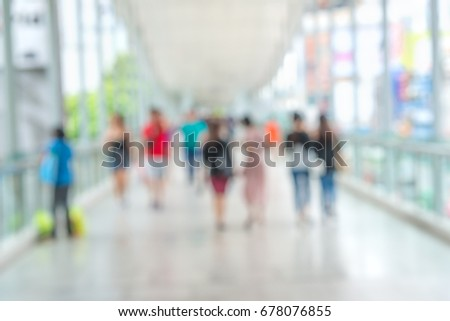 Blurred of people who walking on the sky walk during going to shopping center in the capital city for background #678076855