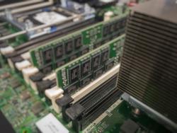 Blurred of ram slot, cpu slot, heat sink, circuit board.