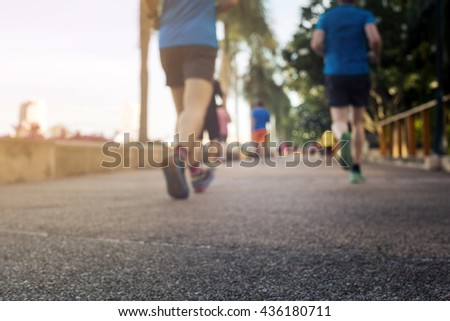 Blurred or De-focus man jogging in the park with gradient effect,Fitness concept. #436180711