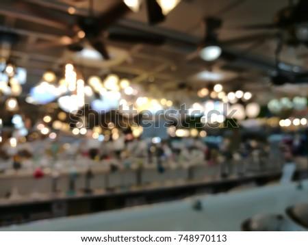 Blurred or Defocus image of bulb shop for bokeh background #748970113