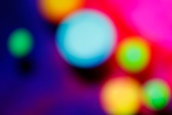 Blurred, out of focus photo, intense bokeh, vivid colors sci-fi atmosphere. Amazing wallpaper backdrop. Colorful light points.
