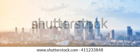 Blurred panoramic background. Modern cityscape with skyscrapers under colorful sky #411233848