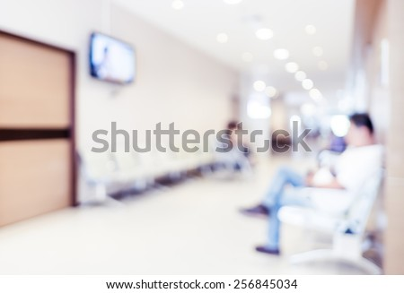 Blurred patient waiting for see doctor,abstract background.