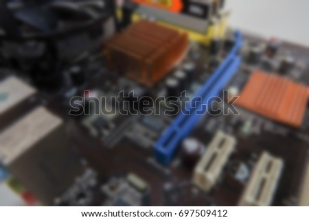 Blurred PCB Closeup of electronic circuit board with CPU processor.