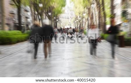 Blurred pedestrian taking a walk in urban background.